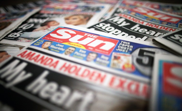 Copies of the first Sunday edition of the Sun newspaper, The Sun on Sunday, are displayed in a supermarket in Slough, U.K. on Sunday, Feb. 26, 2012. News Corp. returned to the Sunday tabloid market in the U.K. today as the company's 80-year-old Chief Executive Officer Rupert Murdoch counts on readers having moved on from the phone-hacking scandal that led to the closure of the News of the World seven months ago. Photographer: Simon Dawson/Bloomberg via Getty Images